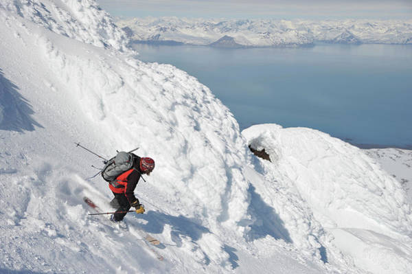 Gulf Of Alaska Photograph - Skiers Descend From The Summit Of  Mt by HagePhoto