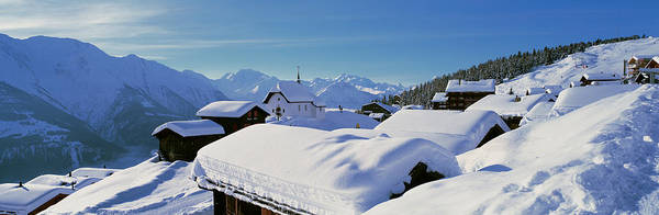 Chalet Photograph - Snow Covered Chapel And Chalets Swiss by Panoramic Images