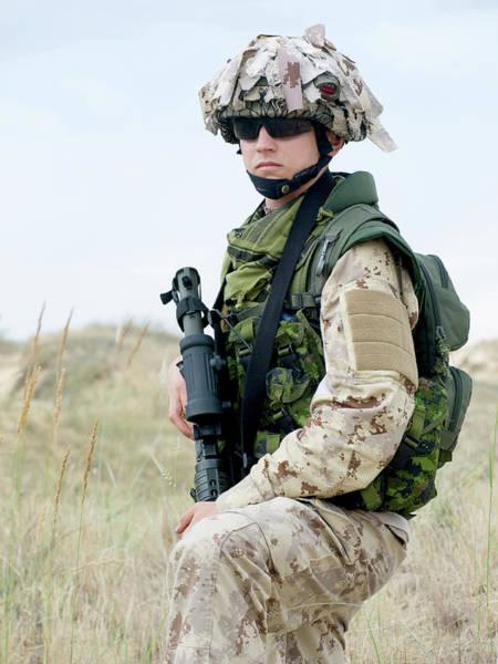 Wall Art - Photograph - Soldier In Desert Uniform Holding by Oleg Zabielin