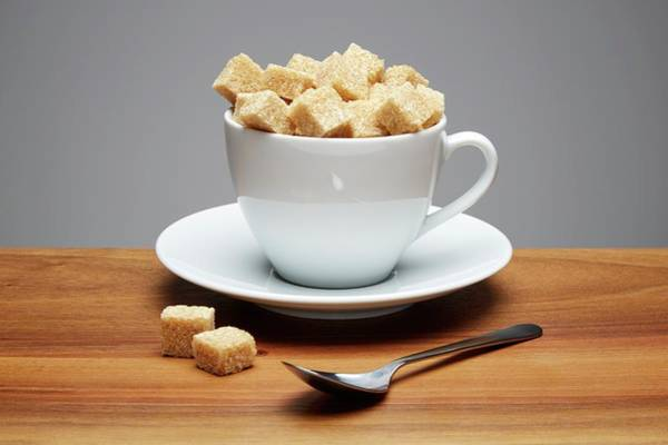 Wall Art - Photograph - Tea Cup Full Of Sugar Lumps by Kevin Curtis/science Photo Library