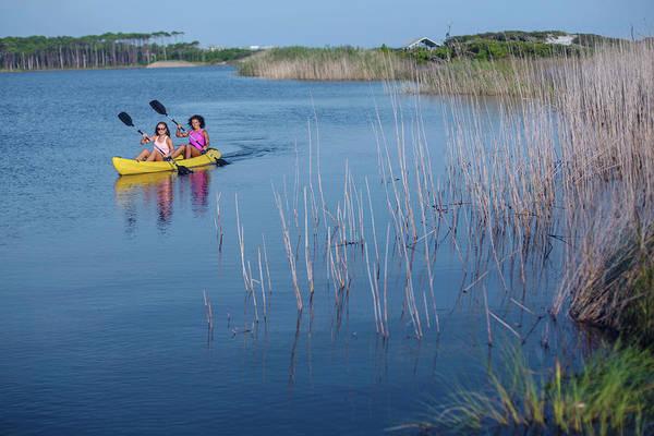 Grayton Beach State Park Photograph - Two Young Woman Kayak On A Lake by Corey Nolen