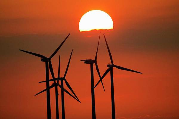 Wall Art - Photograph - Wind Turbines At Sunset by John Thys/reporters/science Photo Library