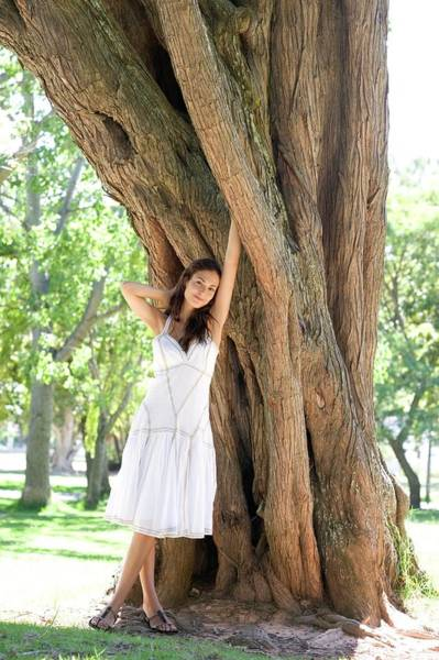Wall Art - Photograph - Woman Leaning Against A Tree by Ian Hooton/science Photo Library