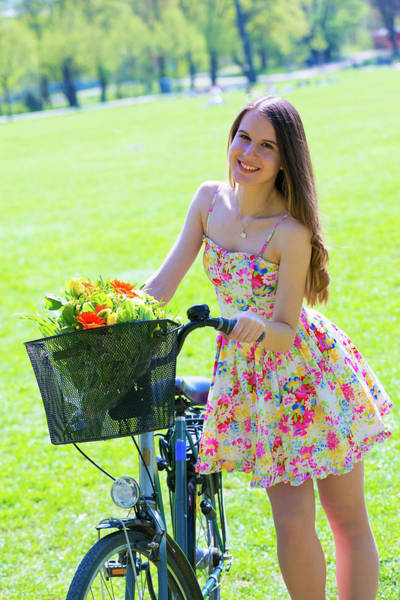 Wall Art - Photograph - Woman On Bicycle With Flowers In Basket by Wladimir Bulgar/science Photo Library