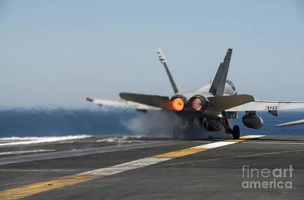 Uss Carl Vinson Photograph - An Fa-18c Hornet Launches by Stocktrek Images