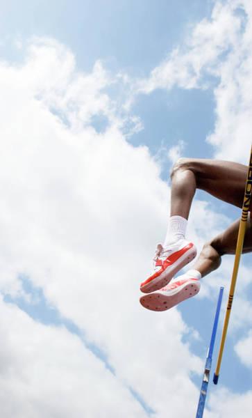 Athlete Performing A High Jump Art Print