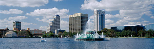 Swan Boats Photograph - Buildings At The Waterfront, Lake Eola by Panoramic Images