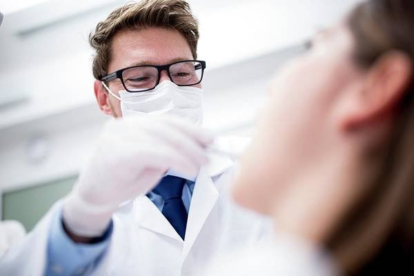 Wall Art - Photograph - Dentist Examining Patient by Science Photo Library