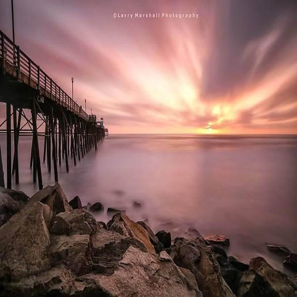 - Long Exposure Sunset At The Oceanside by Larry Marshall