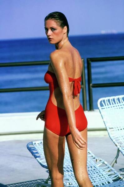 Deck Chair Photograph - Model Wearing A Oleg Cassini Swimsuit by Arthur Elgort