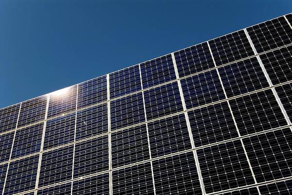 Eco-system Photograph - Solar Panels by Simon Fraser/science Photo Library