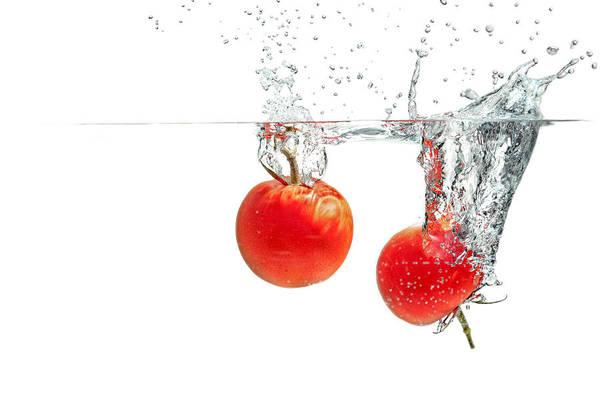 Photograph - Splashing Tomatoes by Peter Lakomy