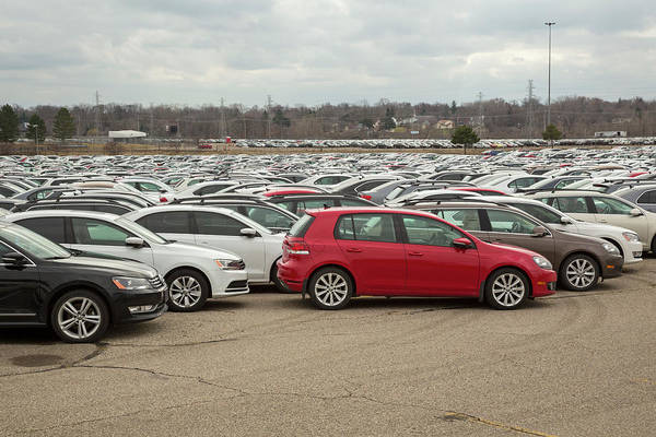 Wall Art - Photograph - Volkswagen Emissions Buyback Cars In Storage by Jim West/science Photo Library