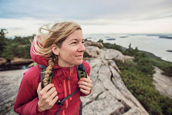 Wall Art - Photograph - Woman Hiking At Summit Of Pemetic by Chris Bennett