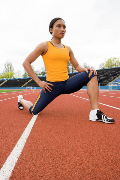 Physical Training Wall Art - Photograph - Athlete Stretching by Gustoimages/science Photo Library