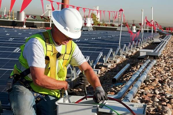 Solar Panels Photograph - Installing Solar Panels by Jim West