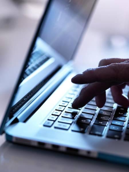 Fraud Photograph - Laptop Use by Tek Image