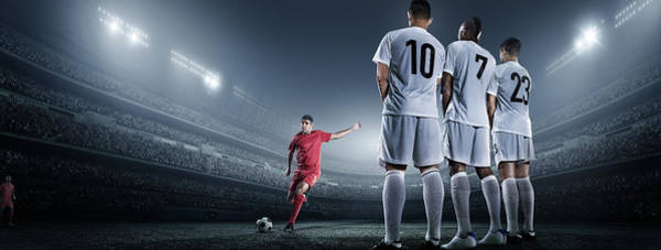 Competitive Sport Photograph - Soccer Player Kicking Ball In Stadium by Dmytro Aksonov