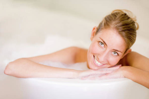 Bath Tub Photograph - Woman Relaxing In A Bath by Ian Hooton/science Photo Library