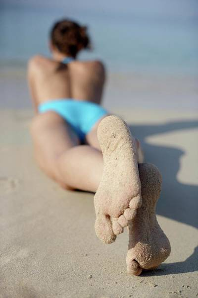 Sunbather Photograph - Woman Sunbathing by Ian Hooton/science Photo Library