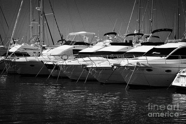 Powerboat Photograph - yachts and powerboats in the port marina Cambrils Catalonia Spain by Joe Fox