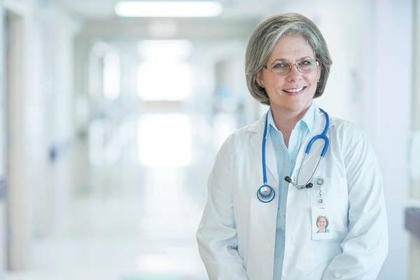 Wall Art - Photograph - Mature Female Doctor Smiling by Science Photo Library