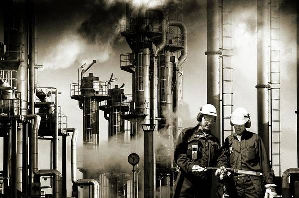 Wall Art - Photograph - Oil Refinery Workers And Pipework by Christian Lagerek/science Photo Library