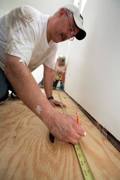 Katrina Wall Art - Photograph - Repairing Hurricane Katrina Damage by Jim West