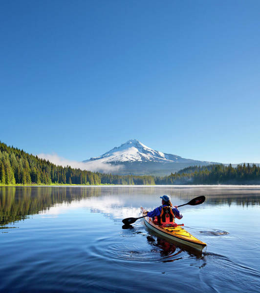 Mt Hood Photograph - Usa, Oregon A Woman In A Sea Kayak by Gary Luhm