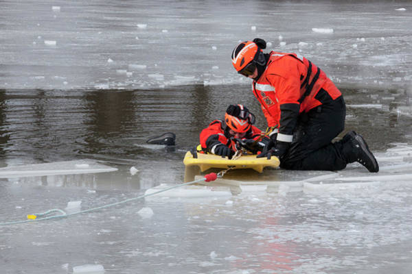 Wall Art - Photograph - Ice Rescue Demonstration by Jim West/science Photo Library