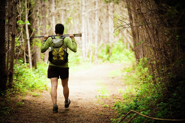 Ns Photograph - Rear View Of A Female Hiker by Ron Koeberer