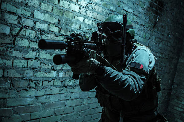 Wall Art - Photograph - Special Forces Operator Pointing Weapon by Oleg Zabielin