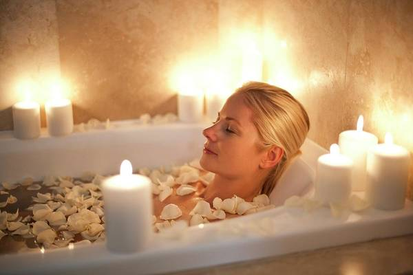 Bubble Bath Photograph - Woman Relaxing In A Bath by Ian Hooton/science Photo Library