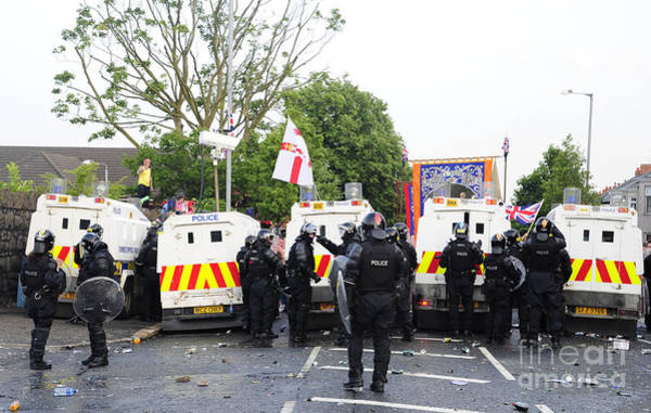 Bracing Photograph - Loyalist Protesters Attack Police Lines by Andrew Chittock