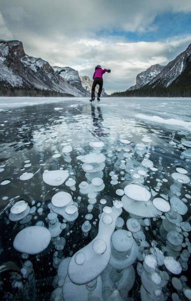 Wall Art - Photograph - Ice Skating At Lake Minnewanka, Banff by Paul Zizka