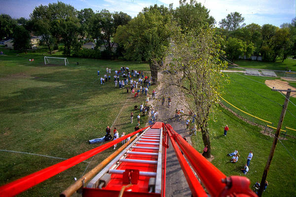 Wall Art - Photograph - 90 Feet Up Fire Truck Ladder View by Thomas Woolworth
