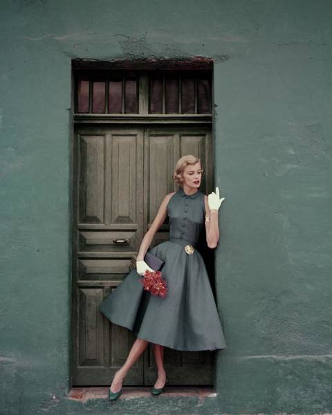 Wall Art - Photograph - A 1950s Model Standing In A Doorway by Leombruno-Bodi
