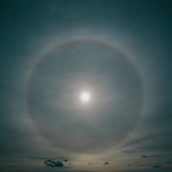 Halo Photograph - A 22 Degree Ice Halo Around The Sun by Dr Jeremy Burgess/science Photo Library