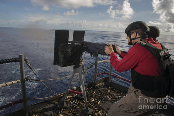 Uss George Washington Wall Art - Photograph - A .50 Caliber Machine Gun Is Fired by Stocktrek Images