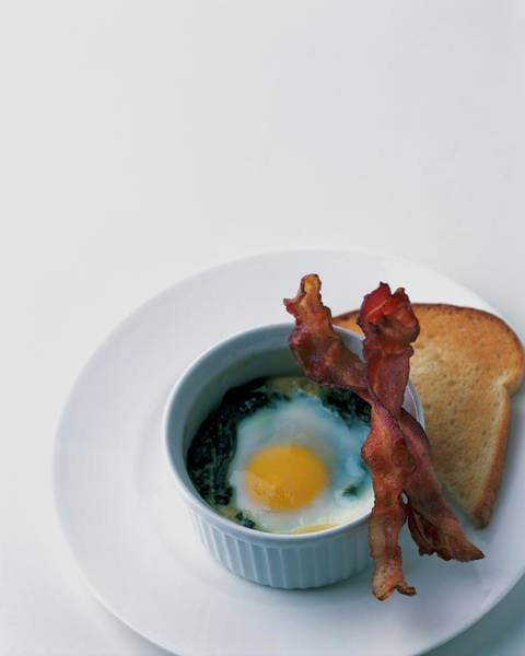 Breakfast Photograph - A Baked Egg With Spinach by Romulo Yanes