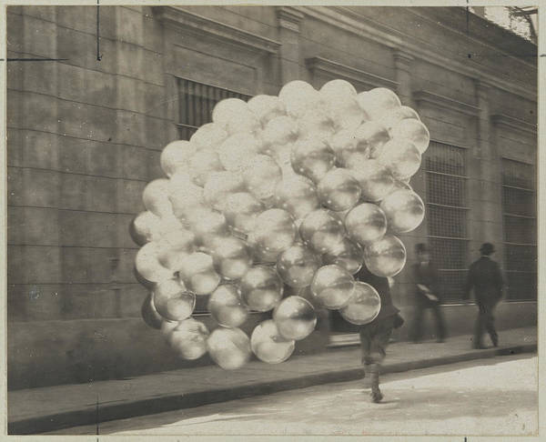 Photograph - A Balloon Vendor Runs Across A Road by Newton W. Gulick