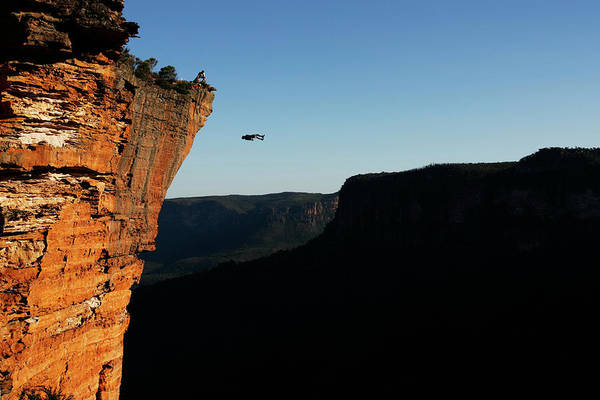Base Jumping Photograph - A Base Jumper Back Flips Off A Cliff by Krystle Wright