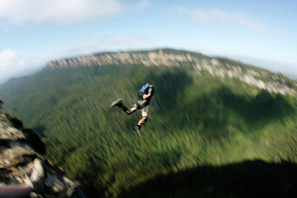 Base Jumping Photograph - A Base Jumper Leaps Off A Cliff by Krystle Wright