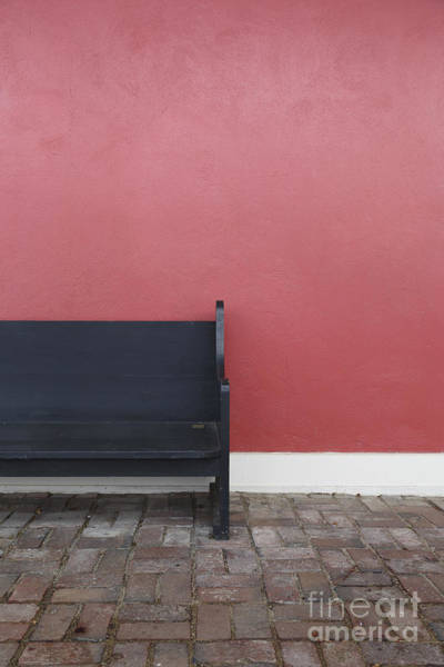 Primary Colors Photograph - A Bench In Front Of A Red Stucco Wall by Edward Fielding