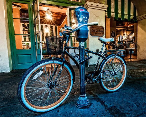 Photograph - A Bike In Front Of Cafe Du Monde In New Orleans by Andy Crawford