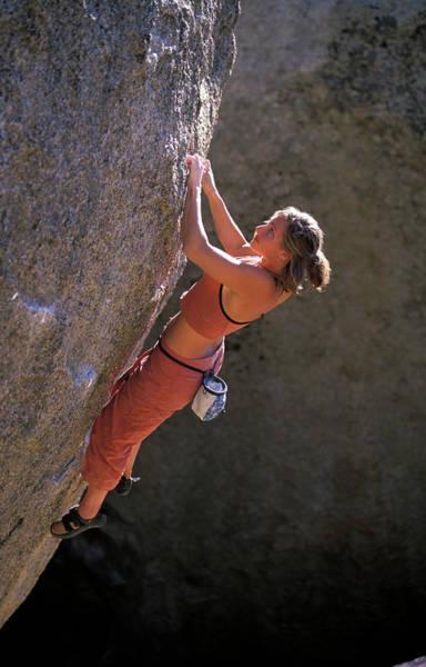 Wall Art - Photograph - A Blond Female Rock Climber Bouldering by Corey Rich