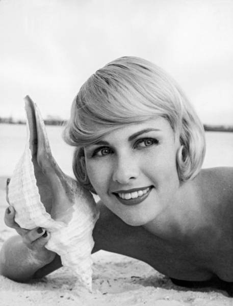 Blonde Photograph - A Blonde And A Shell by Underwood Archives