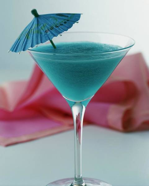 Blue Photograph - A Blue Hawaiian Cocktail by Romulo Yanes