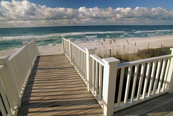 Wall Art - Photograph - A Boardwalk Leads To An Empty Beach by Michael Melford