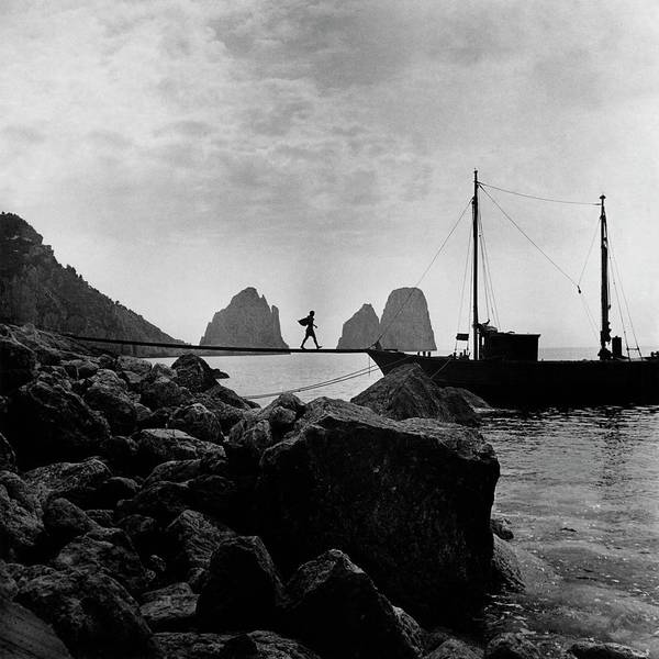 Water Photograph - A Boat Docked At Capri by Clifford Coffin